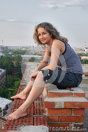 pretty-girl-sits-edge-roof-young-attractive-woman-relaxes-high-building-84294023